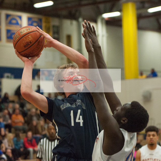 Eagle River's Aaron Davis tries to get a shot off against Bartlett's Gatrak Wall Thursday Feb. 16, 2017. Photo by Michael Dinneen for the Star.