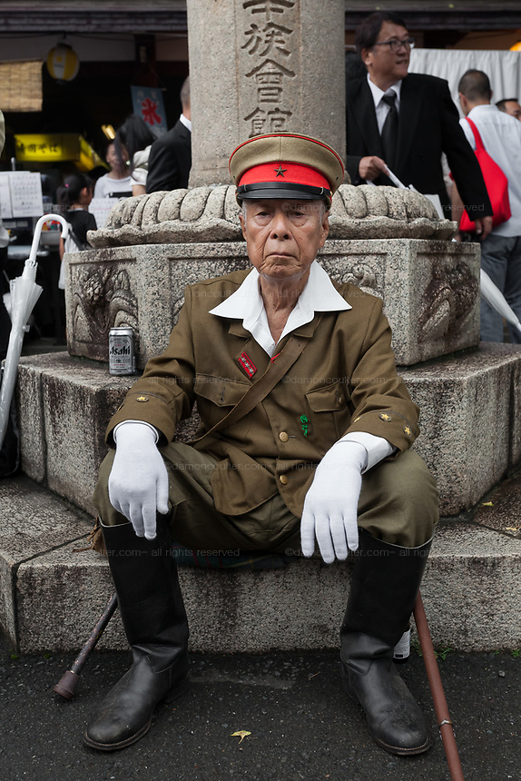 An older Japanese man in Imperial Army uniform las Yasukuni shrine marks the 72nd anniversary of the end of the Pacific War. Yasukuni Shrine, Kudanshita, Tokyo Japan. Tuesday August 15th 2017. Nominally a event to honour Japan's war dead and call for continued peace, this annual gathering  at Tokyo's controversial Yasukuni  Shine also allows many Japanese nationalists to display their nostalgia for their Imperial past.Rightwing paramilitary groups, Imperial cos-players, politicians and many ordinary citizens come together at the shrine to march and wave flags. The day goes almost unreported in the mainstream Japanese media.