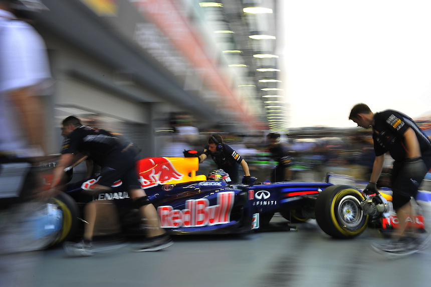 .Sebastian Vettel (GER), Red Bull Racing is wheeled back into the garage ..2012 FIA Formula One World Championship - Singtel Formula One Grand Prix, Marina Bay Street Circuit, Singapore, Singapore, Saturday 22nd September 2012...
