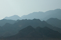 Traveling north on the Kings Highway in Jordan, parallel mountain ranges create a formidable barrier to the east.