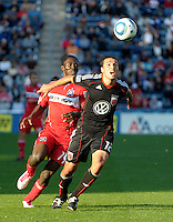 DC United defender Jed Zayner (12) shields the ball from Chicago Fire forward Patrick Nyarko (14).  The Chicago Fire tied DC United 0-0 at Toyota Park in Bridgeview, IL on Oct. 16, 2010.