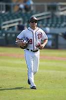 Salt River Rafters hitting coach Luis Ordaz (19), of the Washington Nationals organization, jogs off the field between innings of an Arizona Fall League game against the Glendale Desert Dogs at Salt River Fields at Talking Stick on October 31, 2018 in Scottsdale, Arizona. Glendale defeated Salt River 12-6 in extra innings. (Zachary Lucy/Four Seam Images)