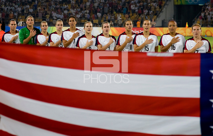 The USWNT sings the Star Spangled Banner before playing at Worker's Stadium.  The USWNT defeated Japan, 4-2, during the semi-finals of the Beijing 2008 Olympics in Beijing, China.