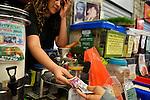A seller gives back change to a customer, at Mahane Yehuda market in central Jerusalem, Israel.<br /> November 30, 2008<br /> Photo by Ahikam Seri
