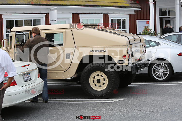 BRENTWOOD, CA - APRIL 4: Arnold Schwarzenegger seen out at Starbucks and eventually getting into is Hummer named Terminator in Brentwood, California on April 4, 2014 SP1/Starlitepics