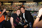 """Days Of Our Lives -Drake Hogestyn and fan  as they sign """"Days Of Our Lives Better Living"""" on September 27, 2013 at Books-A-Million in Nashville, Tennessee. (Photo by Sue Coflin/Max Photos)"""