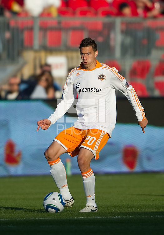 07 May 2011: Houston Dynamo midfielder Geoff Cameron #20 in action during an MLS game between the Houston Dynamo and the Toronto FC at BMO Field in Toronto, Ontario..Toronto FC won 2-1.