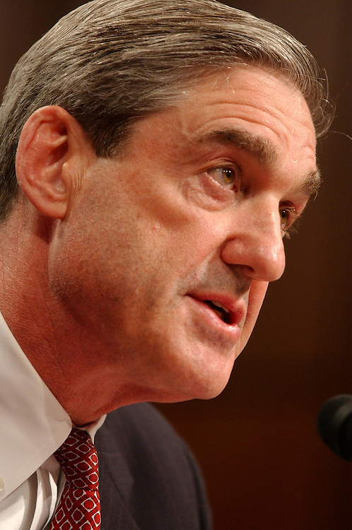 Robert Mueller, Director of the FBI,  testifies before a hearing of the 9-11 Commission, Wednesday, in Hart Building.