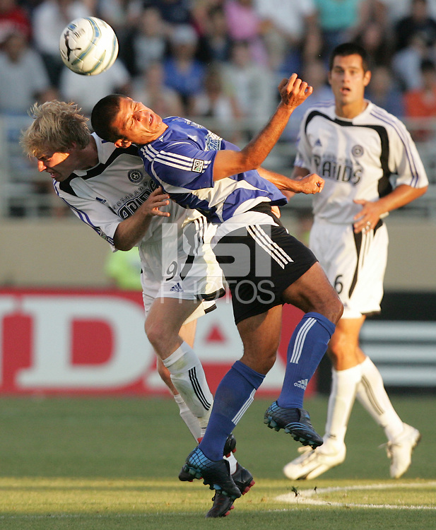 29 June 2005:    Nat Borchers of Rapids battles for the ball in the air with Ronald Cerritos of Earthquakes during the first half of the game at Spartan Stadium in San Jose, California.   Earthquakes tied Rapids at 0-0 at halftime.   Mandatory Credit: Michael Pimentel / ISI