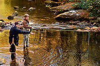 A Boy Scout works on his fly fishing merit badge in a stream in the South Mountain State Park in Connelly Springs, North Carolina.