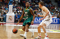 01.04.2012 SPAIN - ACB match played between Real Madrid vs Unicaja  at Palacio de los deportes stadium. The picture show Earl Jerrod Rowland (Unicaja) and  Sergio Rodriguez (Spanish point guard of Real Madrid)