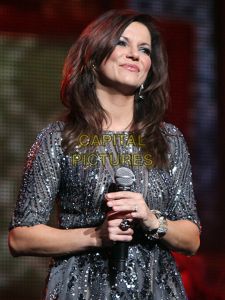 Martina McBride.Country music superstar Martina McBride opened her 2012 Christmas Tour at the historic Fox Theater in Atlanta, GA. McBride performed a wide selection of Christmas songs, along with a couple of her well-known hits, for the sold-out crowd, Atlanta, GA, USA, November 23rd 2012..half length grey gray silver dress sequined sequin beaded stage on music live concert gig microphone singing .CAP/ADM/DH.©Dan Harr/AdMedia/Capital Pictures.