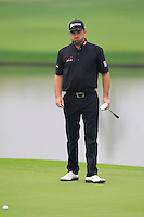 Graeme McDowell (NIR) on the 11th green during Friday's Round 2 of the 2014 BMW Masters held at Lake Malaren, Shanghai, China 31st October 2014.<br /> Picture: Eoin Clarke www.golffile.ie