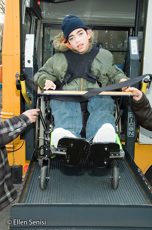 MR / Albany, NY.Langan School at Center for Disability Services .Ungraded private school which serves individuals with multiple disabilities.Child boards schoolbus using wheelchair lift. Boy: 11, cerebral palsy, expressive and receptive language delays.MR: Bro12.© Ellen B. Senisi