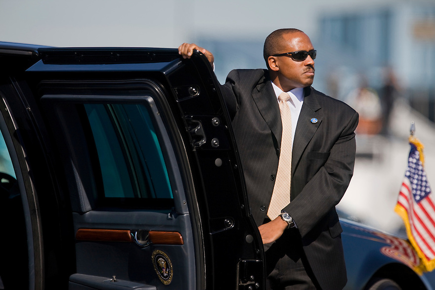 A Secret Service agent opens the door of the Presidential limousine for President Barack Obama as he arrives in at the airport in Albany, NY...Photo by Brooks Kraft/Corbis.......................