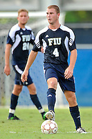 10 September 2011:  FIU's Joseph Dawkins (4) moves the ball upfield in the first half as the FIU Golden Panthers defeated the Stetson University Hatters, 3-2 in the second overtime period, at University Park Stadium in Miami, Florida.