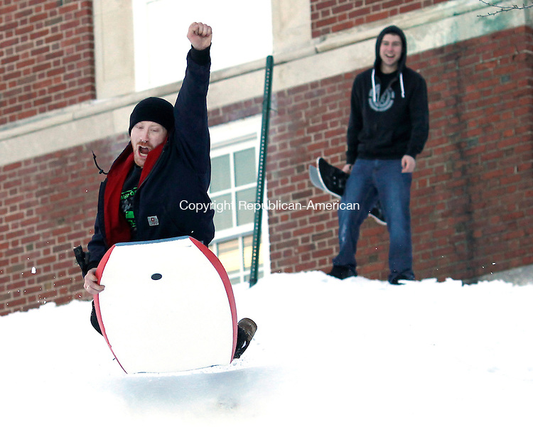Middlebury, CT- 05, February 2011-020411CM01  Conrad Curtis, of Watertown flys off a jump at Shepardson Hill in Middlebury.  Cheering him on is friend, Miguel Fransisco, of Middlebury.  Christopher Massa Republican-American