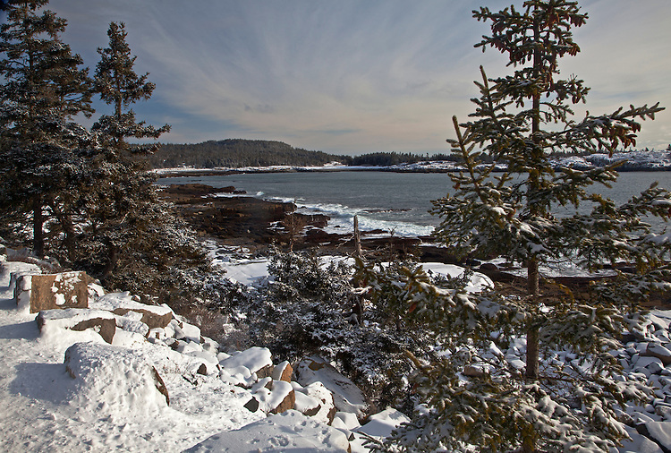 Winter on the Schoodic Peninsula along Arey Cove with Schoodic Point and the Anvil in the background in Acadia National Park, Maine, USA