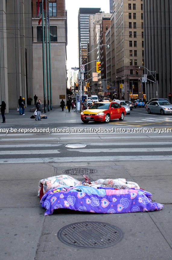 Homeless bed on sidewalk, downtown Toronto