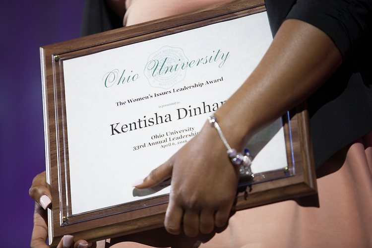 Kentish Dinham holds her Women's Issues and Leadership Award during Ohio University's 33rd Annual Leadership Awards Gala in Baker Ballroom on April 7, 2016. ©Ohio University/ Photo by Kaitlin Owens