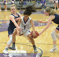 NWA Democrat-Gazette/ANDY SHUPE<br /> Naomi Logan (1) of Fayetteville has the ball stripped by Pam Seiler (right) of Heritage as Sydney Kinnamon defends Tuesday, Feb. 13, 2018, during the first half of play in Bulldog Arena in Fayetteville. Visit nwadg.com/photos to see more photographs from the games.