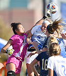 George Washington goalkeeper Tamaki Machi (left) punches the ball out as St. Louis University midfielder Courtney Reimer tried to head the ball into the goal. St. Louis University defeated George Washington in the championship game of the Atlantic 10 Conference Women's Soccer Tournament at Robert Hermann Stadium at St. Louis University on Sunday November 10, 2019.<br /> Photon by Tim Vizer
