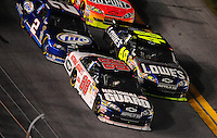 Feb 07, 2009; Daytona Beach, FL, USA; NASCAR Sprint Cup Series driver Dale Earnhardt Jr (88) races alongside teammate Jimmie Johnson (48) during the Bud Shootout at Daytona International Speedway. Mandatory Credit: Mark J. Rebilas-