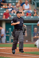 Umpire Sean Ryan follows the action during the game between the Salt Lake Bees and the New Orleans Baby Cakes at Smith's Ballpark on August 4, 2019 in Salt Lake City, Utah. The Baby Cakes defeated the Bees 8-2. (Stephen Smith/Four Seam Images)