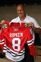 August 7, 2009:  Hall of Fame member Cal Ripken Jr. holds up a Chicago Blackhawks jersey with his name while at the Under Armour All-America practice at Les Miller Field in Chicago, IL.  Photo By Mike Janes/Four Seam Images