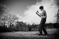 Carolina Chocolate Drops member, Don Flemons, plays the bones in a field near the Stagville Plantation in Durham, North Carolina.