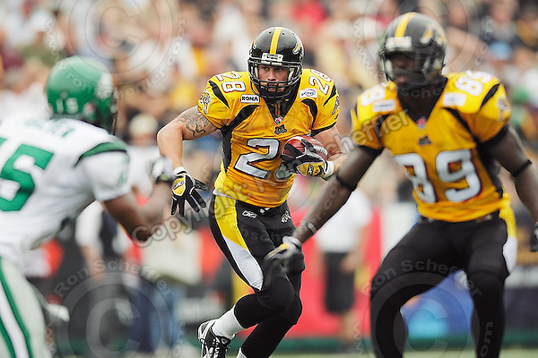 July 12, 2008; Hamilton, ON, CAN; Hamilton Tiger-Cats running back Jesse Lumsden (28) during the CFL football game against the Saskatchewan Roughriders at Ivor Wynne Stadium. The Roughriders defeated the Tiger-Cats 33-28. Mandatory Credit: Ron Scheffler.