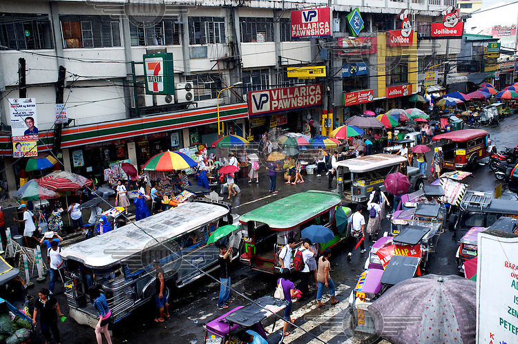 A street crowded with shoppers and jeepneys.