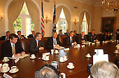 United States President George W. Bush meets National Security Advisors in the Cabinet Room of the White House in Washington, D.C. to develop a stratrgy for responding to the terrorist attacks in New York and Washington on Wednesday, September 12, 2001.  Left to right: US Attorney General John Ashcroft; US Secretary of Defense Donald Rumsfeld; US Secretary of State Colin Powell; President Bush; US Vice President Dick Cheney; Chairman of the Joint Chiefs of Staff Henry Shelton; and National Security Advisor Condolezza Rice..Credit: Ron Sachs / CNP