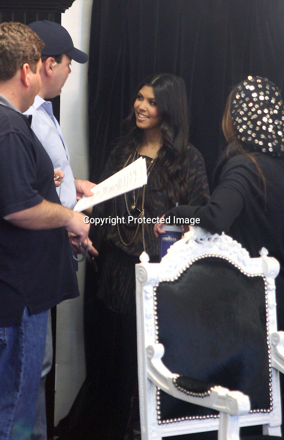 ...1-13-10   January 13th 2010...Kourtney Kardashian & Scott Disick went to the family clothing store Dash in Calabasas California  for a live interview with Jay Leno. . Kourtney's  boyfriend spent most of the time text messaging on his phone during the 5 minute interview. After the interview was over Kourtney looked through some of the clothing inside the shop & hugged up with her boyfriend. About ten fans waited outside the store watching the interview and taking pictures. Everyone outside was laughing at her hair and makeup stylist who looked more like an NFL  football player....AbilityFilms@yahoo.com.805-427-3519.www.AbilityFilms.com.