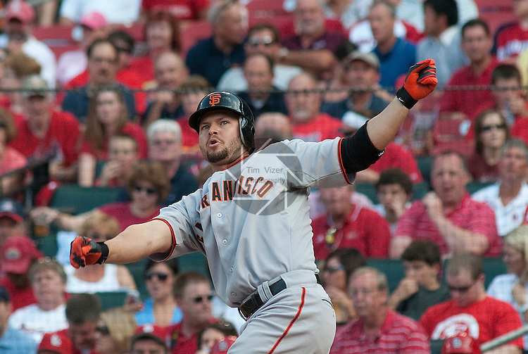 31 May 2011           San Francisco Giants left fielder Cody Ross (13) watches the bat sail into the stands down the third base line.  It hit a small girl but didn't seriously injure her. The St. Louis Cardinals defeated the San Francisco Giants 4-3 on Tuesday May 31, 2011 in the second game of a four-game series at Busch Stadium in downtown St. Louis.
