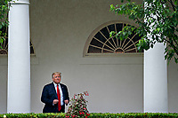 United States President Donald J. Trump adjusts his jacket while standing in the Colonnade of the White House after a Rolling to Remember ceremony honoring the nation's veterans and prisoners of war/missing in action (POW/MIA) in Washington, D.C., U.S., on Friday, May 22, 2020. Trump didn't wear a face mask during most of his tour of Ford Motor Co.'s ventilator facility Thursday, defying the automaker's policies and seeking to portray an image of normalcy even as American coronavirus deaths approach 100,000. <br /> Credit: Andrew Harrer / Pool via CNP /MediaPunch