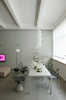 "A vibrant pink video installation ""In and Out"" by Claude Closky makes a bold statement on a wall of the living area"