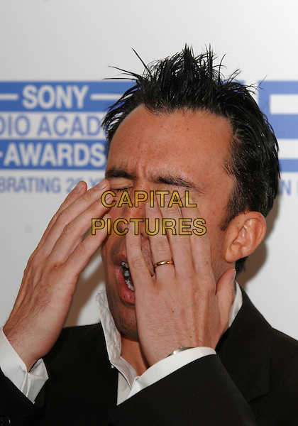 CHRISTIAN O'CONNELL.Attending the Sony Radio Academy Awards,.Grosvenor House Hotel, .London, England, April 30th 2007..portrait headshot hands over face funny hiding.CAP/PL.©Phil Loftus/Capital Pictures