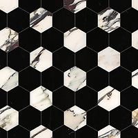 Hex, a waterjet stone mosaic, shown in polished Plumeria and Nero Marquina, is part of the Semplice™ collection for New Ravenna.