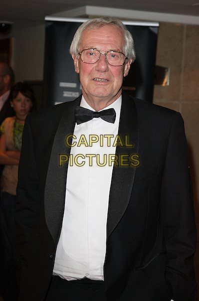 BARRY NORMAN.Screen Nation Film & Television Awards 2007, Hilton London Metropole, London, England..October 15th, 2007.half length black tuxedo jacket bow tie glasses.CAP/ROS.©Steve Ross/Capital Pictures