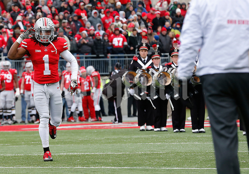 Ohio State Buckeyes cornerback Bradley Roby (1) salutes Head Coach Urban Myer as he approaches him during a Senior Day celebration at Ohio Stadium in Columbus, Ohio on November 23, 2013.  (Chris Russell/Dispatch Photo)