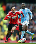 Chris Smalling of Manchester United escapes Yaya Toure of Manchester City during the Barclays Premier League match at the Etihad Stadium. Photo credit should read: Philip Oldham/Sportimage