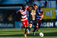 Daniel Cruz (44) of the Philadelphia Union is marked by Jair Benitez (5) of FC Dallas. The Philadelphia Union and FC Dallas played to a 2-2 tie during a Major League Soccer (MLS) match at PPL Park in Chester, PA, on June 29, 2013.