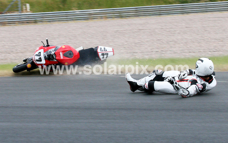 **ALL ROUND PICTURES FROM SOLARPIX.COM**.**SYNDICATION RIGHTS FOR UK AND SPAIN ONLY**.Motorsport motorbike IDM Superbike Training in Sachsenring the Former Formula 1 racing driver Michael Schumacher during his accident on his bike. .Schumacher was not  injured. From 20th till 22nd a race of the International German Motorbike championship will take place at the Sachsenring in the city of Hohenstein Ernstthal in Germany..JOB REF:6625- CPR/Ralph Koehler        DATE:12_06_08.**MUST CREDIT SOLARPIX.COM OR DOUBLE FEE WILL BE CHARGED* *UNDER NO CIRCUMSTANCES IS THIS IMAGE TO BE REPRODUCED FOR ANY ONLINE EDITION WITHOUT PRIOR PERMISSION*