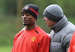 Patrice Evra gets a pat on the head from manager Sir Alex Ferguson during training before the champions league fixture against Barcelona. Picture date 28th April 2008. Picture credit should read: Simon Bellis/Sportimage