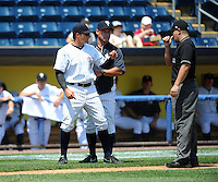Staten Island Yankees manager Justin Pope (22) is thrown out of game by umpire David Arrieta while yankee coach Ty Hawkins tries to bring Pope back to bench during game against the Batavia Muckdogs at Richmond County Bank Ballpark at St.George on July 18, 2013 in Staten Island, NY.  Batavia defeated Staten Island 8-2.  (Tomasso DeRosa/Four Seam Images)