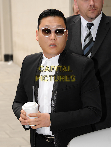Psy - Park Jae Sang<br /> At BBC Radio 1, London, England.<br /> June 10th, 2013<br /> half length black suit white shirt sunglasses shades takeaway cup drink beverage mouth open<br /> CAP/AOU<br /> &copy;AOU/Capital Pictures