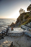 USA, California, Big Sur, Esalen, a woman fixes her suit at the Baths with the Pacifc Ocean in the distance, the Esalen Institute