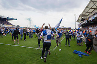 Bristol Rovers fans celebrate promotion on the pitch after the Sky Bet League 2 match between Bristol Rovers and Dagenham and Redbridge at the Memorial Stadium, Bristol, England on 7 May 2016. Photo by Mark  Hawkins / PRiME Media Images.