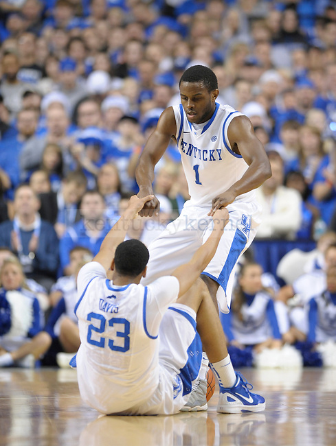 Darius Miller (1) picks up teammate Anthony Davis (23) during the first half of the University of Kentucky Basketball game against Loyola at Rupp Arena in Lexington, Ky., on 12/22/11. UK led at half 45-39. Photo by Mike Weaver | Staff